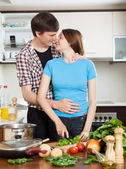 Couple having flirt at kitchen — Stockfoto