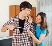 Woman measuring  bust of boyfriend  — Stock Photo