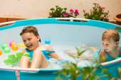 Children swimming in pool — Stock Photo
