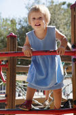 Baby girl at action-oriented playground — Stock Photo