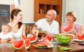Smiling happy three generations family eating watermelon  over   — Stock Photo