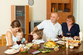 Three generations family posing together — Stock Photo