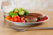 Two grilled cutlets with vegetables — Photo