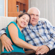 Loving mature couple on sofa — Stock Photo #57460303