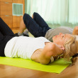 Mature couple doing exercises — Stock Photo #57460541