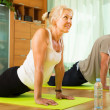 Mature couple doing exercises — Stock Photo #57460551