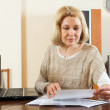 Blonde woman with documents — Stock Photo #57460757