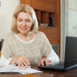 Mature woman with documents — Stock Photo #57460759