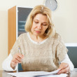 Woman filling in financial documents — Stock Photo #57460767