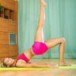 Female doing yoga at home — Stock Photo #57461987