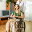 Physician and disabled girl communicating — Stock Photo #57463971