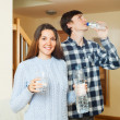 Smiling couple  drinking clean water  — Stock Photo #57464087