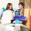 Happy family with clothes and shopping bags — Stock Photo #57464199