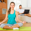 Female in yoga position and lazy guy on sofa — Stock Photo #57468103