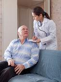 Mature doctor and senior man — Stock Photo