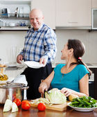 elderly man and mature woman  doing housework together   — Stock Photo