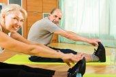Senior couple doing exercises indoor — Stock Photo