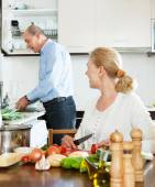Loving elderly couple doing housework and cooking together — Stock Photo