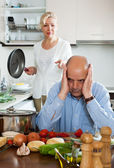 Family conflict in kitchen — Stock Photo