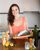 Housewife cooking fish — Stock Photo