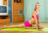 Cheerful girl doing yoga at home — Foto Stock