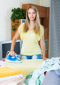 Blonde housewife ironing with iron — Stock fotografie