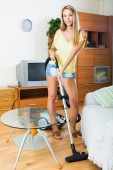 Housewife cleaning with vacuum cleaner — Stock Photo