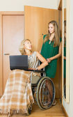 Happy woman in wheelchair  working on laptop  — Stock Photo