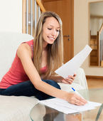 Female freelancer working with documents — Stockfoto