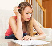 Tired woman studying notes — Stock Photo