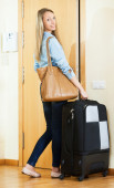 student with baggage ready to leave town for weekend — Stock Photo