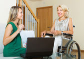 Insurance agent and disabled woman — Stock Photo