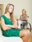 Woman and handicapped female having quarrel — Stock Photo