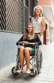 Happy woman in wheelchair  outdoor — Stock Photo
