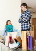 Woman showing purchases to boyfriend — Stock Photo