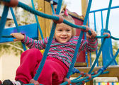 Excited girl at playground — Stock Photo