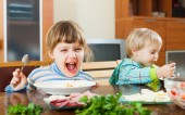 Happy children eating food — Stock Photo