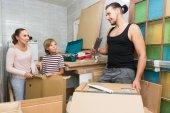 Family unpacking boxes — Stock Photo