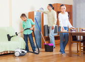 Family cleaning with vacuum cleaner — Stock Photo