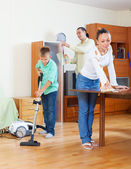 Family cleaning in home — Стоковое фото