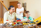 Family with working tools — Stock Photo