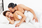 Awaking couple in bed   — Stock Photo
