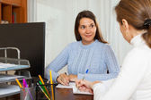 Woman answer questions of employee — Stock Photo