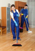 Handsome cleaners team working — Stock Photo