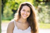 Smiling girl in summer park — Stock Photo