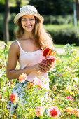 Woman gardening with roses — Foto Stock