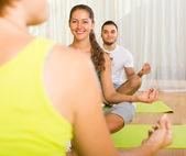 Group having yoga class  — Photo