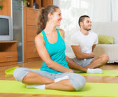 Couple practicing yoga at home — Stock Photo