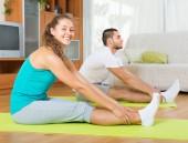 Couple having yoga class — Foto de Stock