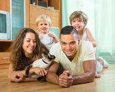 Family playing with kitten — Stock Photo